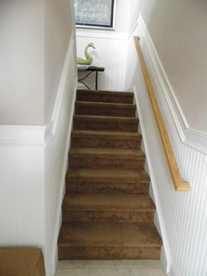 Entering the condo: Come the spring the rug is going and we are staining the steps and banisters ebony