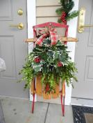 This has lots of memories - this was Kristin & Aly's sled long time ago - which makes it so special to display at our front door