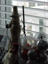 The glass jar is from Pottery Barn and just filled with small ball ornaments - little snow man in the background