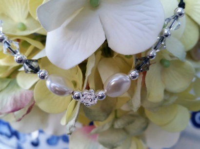 Pretty coin pearl, swarovski crystals and sterling silver rose necklace go to ~ https://www.etsy.com/listing/218782506/coin-pearl-and-swarovski-crystal