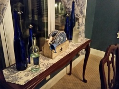 I used the sofa table from the Family Room to display these items