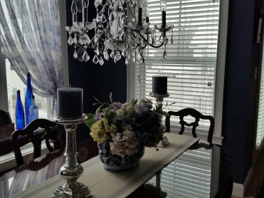 I am so pleased with how the Dining Room came out. The candle sticks were purchased at Pottery Barn, same with the candles. The floral centerpiece was arranged by a local florist. I had the blue & white urn - purchased at Bombay & Co.