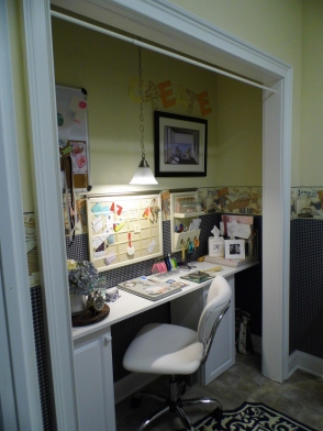 This was once a closet my husband took the doors off and all the shelving came down. He painted the space to match the laundry room - added the same wallpaper and border. Used two kitchen cabinets centered them inside the space. Purchased a long piece of formica for the work space. Put in task lighting, and the rest is history.