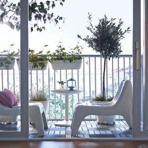 Here is my inspiration - I always thought you had to put the chairs next to each other, but after seeing this picture I thought this would be so much better for our little balcony