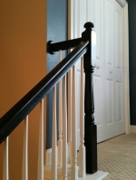 Top of stairs. I love the black banisters.