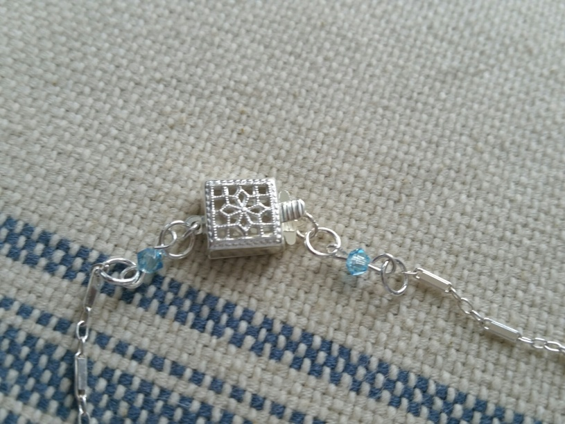 Swarovski birthstone crystals of either side of clasp ~