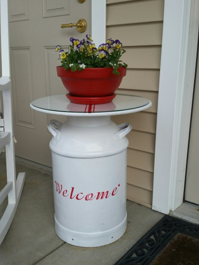The milk jug was red ~ Pete spray painted it white, then I stenciled the Welcome ~ I also used E6000 glue around the rim of the milk jug then attached the round top ~ It's there to stay ~